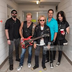 Eric Levy, Brad Gillis, Jack Blades, Kelly Keagy, and Keri Kelli of Night Ranger pose backstage at The Amphitheater at Coney Island Boardwalk on August 18, 2016 in New York City.
