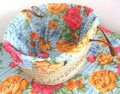 Line a basket with colorful cloth. Use snaps or velcro and create aseries of changeable liners.