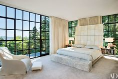 """The master bedroom, which the architect likens to """"a cocoon,"""" was rendered in natural materials and a pale palette to create a feeling of tranquillity. Kundig and the firm's Debbie Kennedy designed the bed. Maxalto chair."""