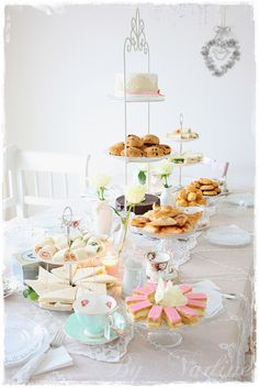 The treats are the main attraction on this prettyhigh tea table.