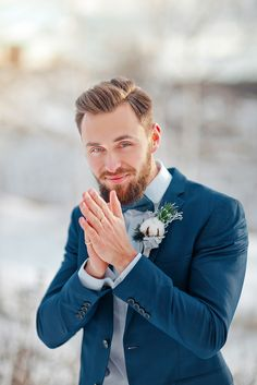 Groom in blue suit+ Muted grays and blues For an outdoor winter wedding shoot in the snow | fabmood.com #winterwedding #groom #snow
