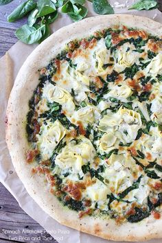 Spinach artichoke pesto pizza from Two Peas and Their Pod