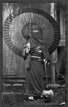 Woman in winter clothing, Nagasaki, 1868: the hood is to protect her face from the wind