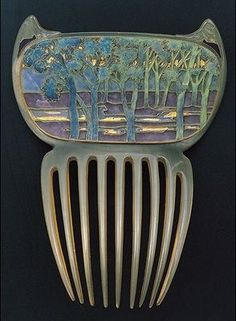 Lalique's famous Landscape Comb at the Gulbenkian Museum; made of enameled glass encased in horn: pinned from Barbaraanne's Hair Comb Blog