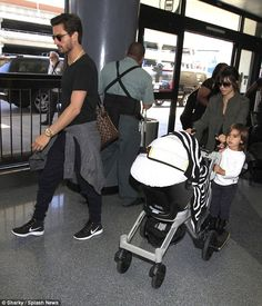 Scott Disick and Family in the Airport. Check out the Flyknit Chukka's on feet.