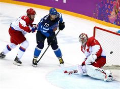 Juhamatti Aaltonen (#50) of Finland scores a first-period goal against Semyon Varlamov (#1) of Russia, as Nikita Nikitin (#6) of Russia defends during the Men's Ice Hockey Quarterfinal Playoff on Day 13 of the Sochi 2014 Winter Olympics, at the Bolshoy Ice Dome. Sochi 2014 Day 13 - Ice Hockey Men's Play-offs Quarterfinals Russia V Finland.