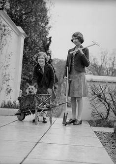 Princess Margaret Rose and Princess Elizabeth on a terrace of the Royal Lodge, Windsor with gardening equipment and a pet corgi dog. Get premium, high resolution news photos at Getty Images Santa Lucia, Royal Lodge, Edinburgh, Prinz Philip, Margaret Rose, Isabel Ii, Her Majesty The Queen, Queen Of England, Royals