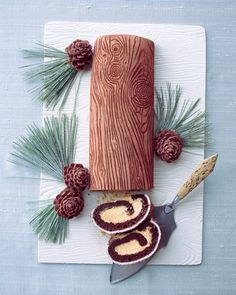 Yule Logs -- Take Christmas to the next level with this highly detailed Yule log cake, complete with wood-grain pattern and chocolate pinecones.
