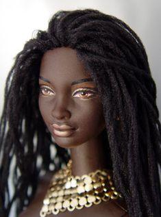 Dark-skinned Black doll with 'locks.