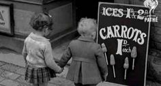 """During World War II, when sugar was rationed to 8 ounces per adult per week, some vegetable alternatives were introduced. These girls don't seem too happy about the """"carrot-on-a-stick"""" option. Image courtesy of the World Carrot Museum."""