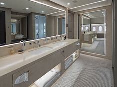 The massive master bathroom features a set of large marble his and hers sinks.