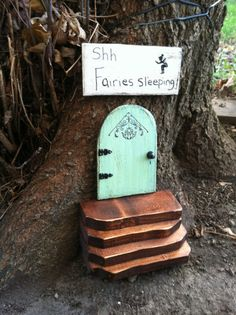 Garden fairy door set (door, stairs and sign), $33, by WoodenBLING on Etsy