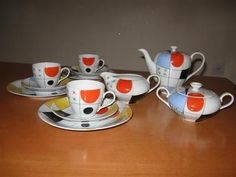 This is a Vintage Art Deco Wawel Poland Hand Painted ( RECZNIE MALOWAN ) Porcelain Tea / Coffee Set for 3 . Including 3 cups & saucers , 3 cake plates , A milk jug , Sugar bowl & a coffee / tea Pot.