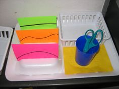 Strategy: Cutting task box. Helpful for students with autism to work with scissors. Also spacial awareness.