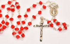 Rosary Beads, rosaries and chaplets containing Lourdes water drawn from the miraculous spring at the grotto. All our Lourdes Rosaries represents the scene of the apparitions and are dedicated to Our Lady of Lourdes and Saint Bernadette. Rosary Necklace, Rosary Beads, Virgin Mary Necklace, Our Lady Of Lourdes, Swarovski Crystals, Rosaries, Drop Earrings, Sterling Silver, Red