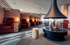Icelandair Lounge in Keflavik, Island Metal Fireplace, Oak Frame House, Wood Heater, Contemporary Fireplace, Wood Fireplace, Fireplace Design, Modern Fireplace, Danish Interior, Lounge