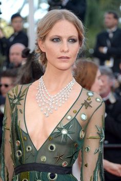 Poppy Delevingne's braided updo and sultry eyeliner look at Cannes Film Festival