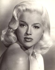 """Diana Dors was an English actress, born Diana Mary Fluck in Swindon, Wiltshire. Considered the English equivalent of the blonde bombshells of Hollywood, Dors described herself as """"the only sex symbol Britain has produced since Lady Godiva"""""""