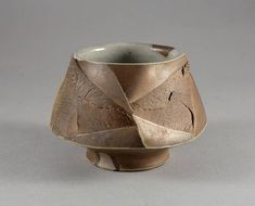 Yunomi, tea bowl just for drinking. Also suitable as coffee cup. Faceted shape and original texture made in very special way. White glaze. Created in a wabi-sabi aesthetic way by Mikhail Tovstous, Ukrainian ceramic artist. Wheel thrown, handcut, glazed and wood fired at Pottery Park