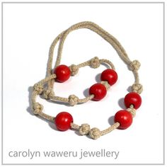 Celtic knot and wooden bead necklace by CarolynWaweru on Etsy