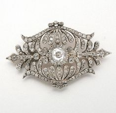 GOLD, SILVER AND DIAMOND BROOCH, LATE 19TH CENTURY 1 and 110 diamonds approx 1.05 & 2.40 cts.