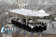Belgium - 50 meters above ground dining event arranged by a professional event arranger of Benji Fun company. It provides seating for 22 complete with Chef, server, musician and you can select your own location without limitation. Guaranteed safety with the hoisting crane which can accommodate a whole band of musicians.