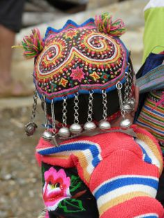 Vietnam | Details from a child's hat at the market in Bac Ha | ©Jacky Cudon
