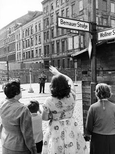West Berliners wave to relatives in East Berlin on Aug. 13, 1962.