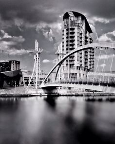 Instead of building walls, we should be building bridges. #VicenteFox  #architecture #art #bnw #bnw_perfection #blackandwhite_photography #buildings #waterscape #river #cityscape #street_photography #pattern #skyline #wanderlust #explorer #exploring #travelinstagram #photooftheday #modern_architecture #momentoftheday #iphonegraphy #iphone_shot #ks #naturelover #vintage