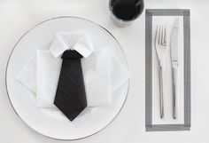 """This could be a cute folded napkin idea for a boys First Communion or Confirmation -- especially if you added a cross or chalice shaped sticker as a small """"tie tack""""!"""
