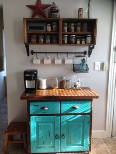My completed coffee bar. I used a hutch my father made for my mother 30-40 years ago. I distressed the doors and updated the hardware.The shelving is craft crates stained and modified hanging up by brackets. The coffee mug bar is from Ikea. Enjoy :)