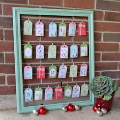 Advent Calendar {Christmas Tutorial}- what a fun idea! Use an old frame, twine, tabs and your imagination to create a fun Advent Calendar for the whole family! Homemade Advent Calendars, Advent Calendars For Kids, Diy Advent Calendar, Calendar Ideas, Christmas Countdown Calendar, Christmas Love, Christmas Holidays, Christmas Decorations, Xmas