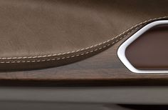 bmw concept leather detail wood door stitches line join material natural car interior