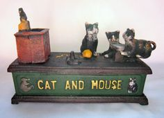 Saving is much easier to instill in the young when it becomes a game. The old game of cat and mouse is replayed with this cute cast iron mechanical bank. Add a coin to the plate in front of the three cats and then pull the lever. Watch the cat fly across the floor and drop the coin in the sink in front of the mouse. How fun!!