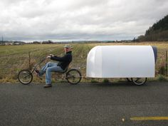 """My latest Corrugated plastic bicycle camper, using reclaimed Campaign signs, one bicycle, 1x2"""" wood frame weighing 45 pounds empty. It has a kitchen galley, plenty storage and roomy interior."""