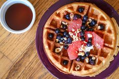 Lately nothing has been aseasy or delicious in the morningas a fresh  waffle with fruit, yogurt, and nuts. I can whip up the batter the night  before (takes about 10 minutes),put it in the fridge, and the next morning  all I have to do is warm up the waffle iron and the maple syrup! Many  waffle recipes have canola oil and sugar and don't even hold me over until  lunch, so I made this recipe to produce a more nutritious and filling  waffle witha great texture and taste!  Ingredients…