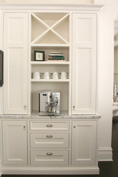 Another view of the custom cabinetry of the Lake Michigan Home. By the fridge?