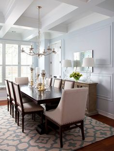 Dining room designed by Heather Scott Home & Design using Surya's Market Place rug by Candice Olson in Cream/Blue