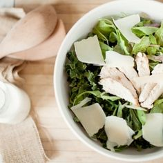 Grilled Chicken Caesar Salad: tangy Greek yogurt-based Caesar dressing atop greens and kale with grilled baguette croutons and chicken.