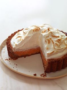 Candied yam pie topped with a glorious pile of meringue.