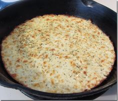 Baked Cauliflower Pizza Crust..never thought of using an iron skillet for this. Clever!!