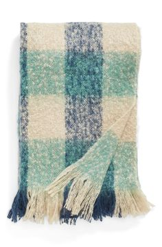 This blue color-pop plaid throw blanket is sure to amplify the cozy-chic appeal of the living room décor.