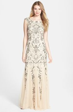Free shipping and returns on Adrianna Papell Beaded Mermaid Gown (Regular & Petite) at Nordstrom.com. Polished beads and sequins chart intricate tapestry patterns down the sleeveless bodice and diaphanous skirt of a sweeping evening gown flared by wispy godets.