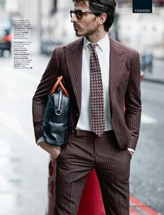 Andres Velencoso Segura is pictured in a brown pinstripe suit from Ralph Lauren Purple Label.
