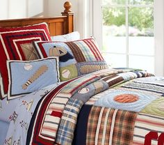 Big boy toddler room. Pottery Barn bedding & pull-out trundle bed