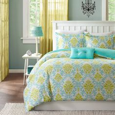 The Mizone Paige duvet cover set is the perfect way to add color and style to your bedroom. This duvet cover set brings in a great combination of turquoise blue with an apple green color to create a fun damask pattern.
