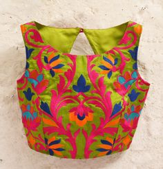 Green Padded Silk Blouse with Bright Floral Embroidery and Fuschia Raw Silk detail at Back. Comes in Size (S)