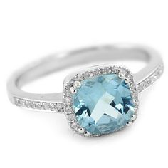 blue topaz - december birthstone...Erica has one almost exactly like this that she never wears.