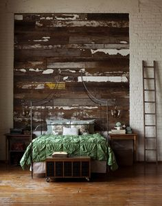 would love to do the wall behind our bed or somewhere else in the house like this ... just find a pile of old wood - with paint peeling - and cut to fit a space on a wall ... LOVE this
