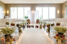 This bride decorated her ceremony space with photo garlands and pretty heart motifs.